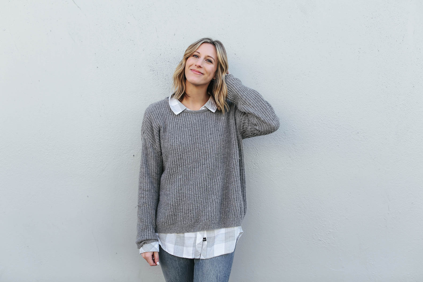 sweater layered over button-down shirt