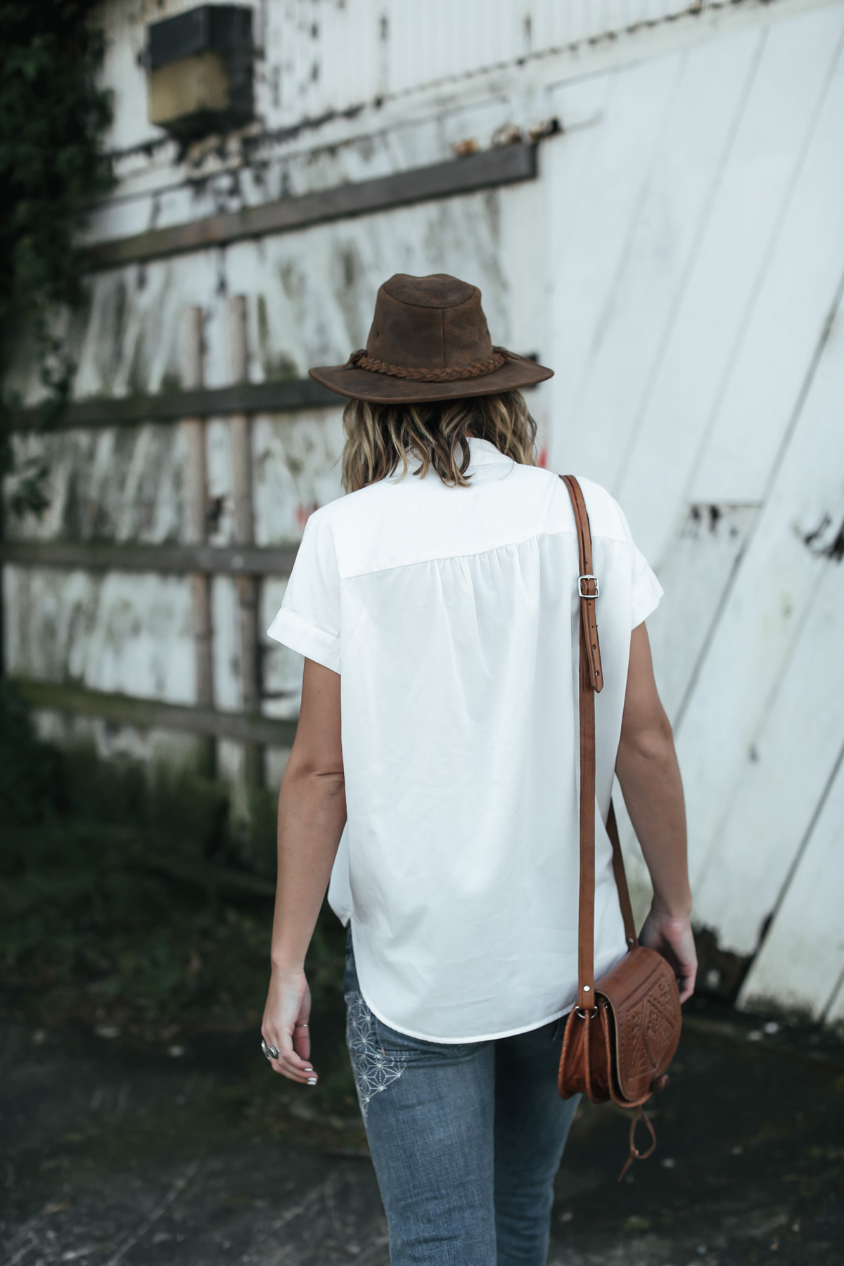 brown leather hat and white button-down