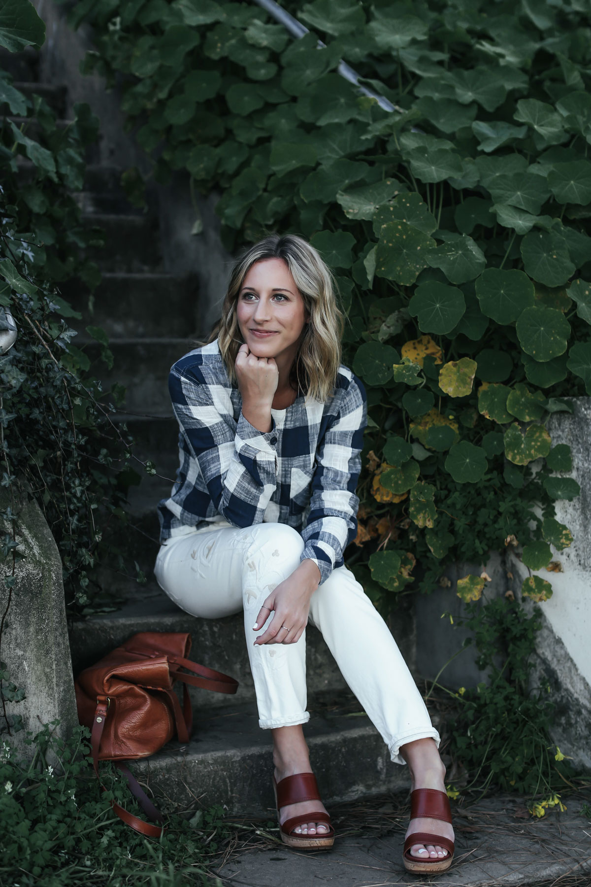 white embroidered denim and gingham top outfit from Anthropologie