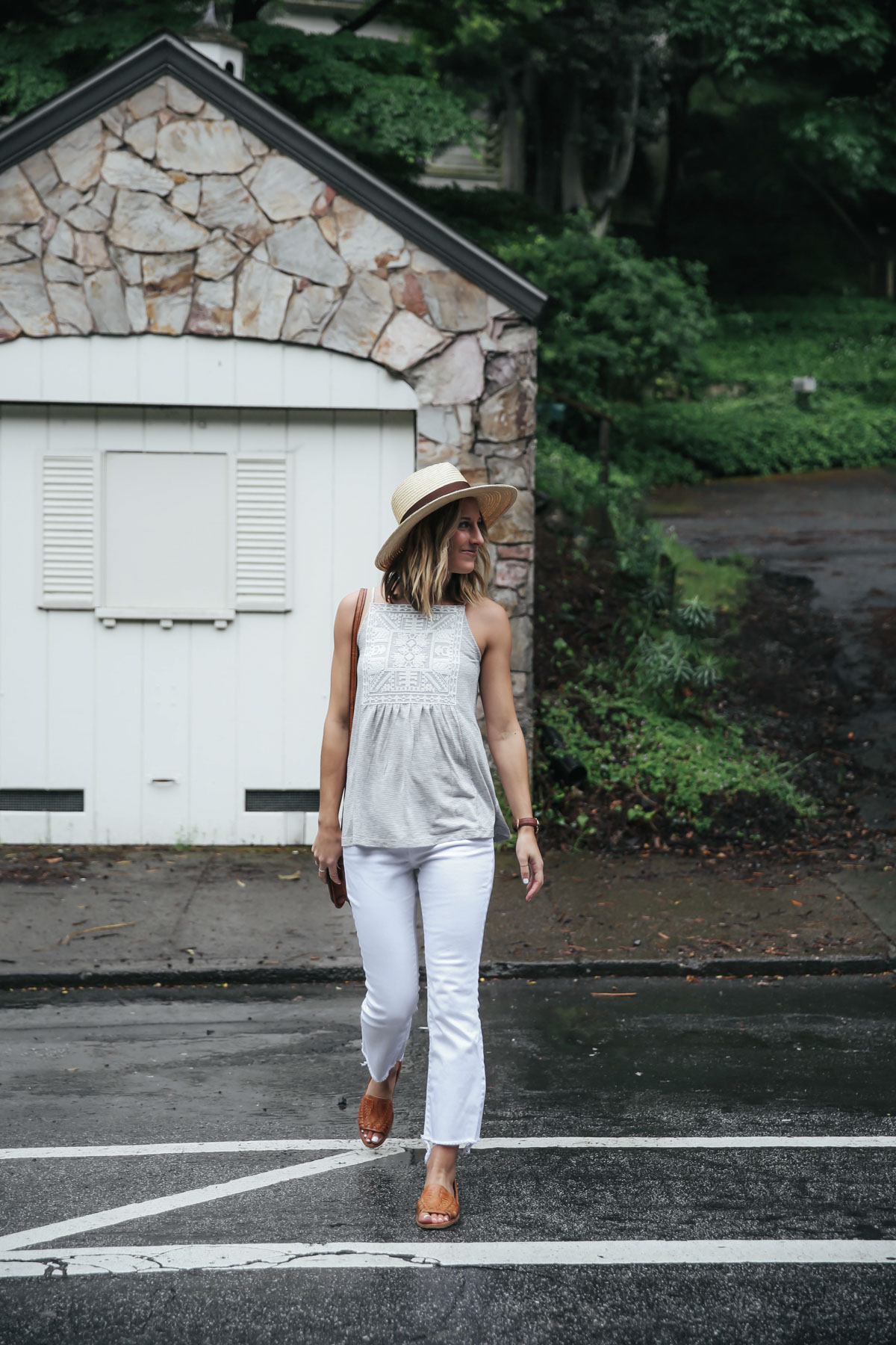 Amanda Holstein in white cropped flare jeans and summer top