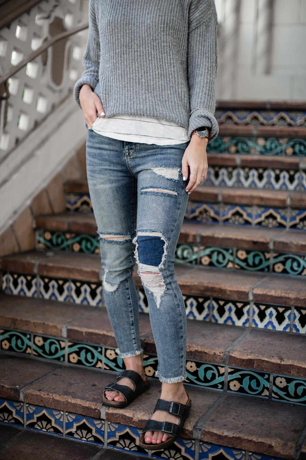 basic outfits with distressed denim, sweater, and birkenstock sandals