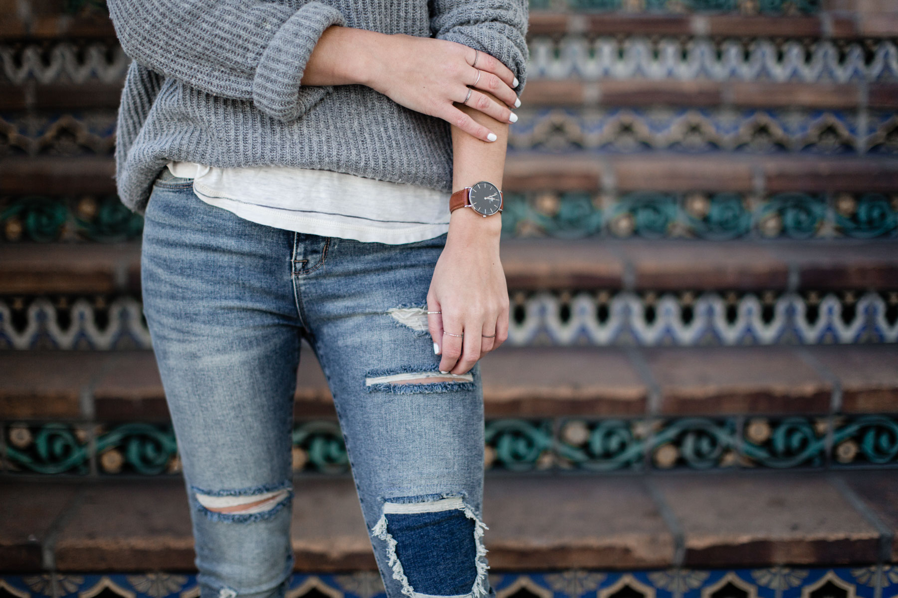 basic outfits with distressed denim, sweater, and striped tee