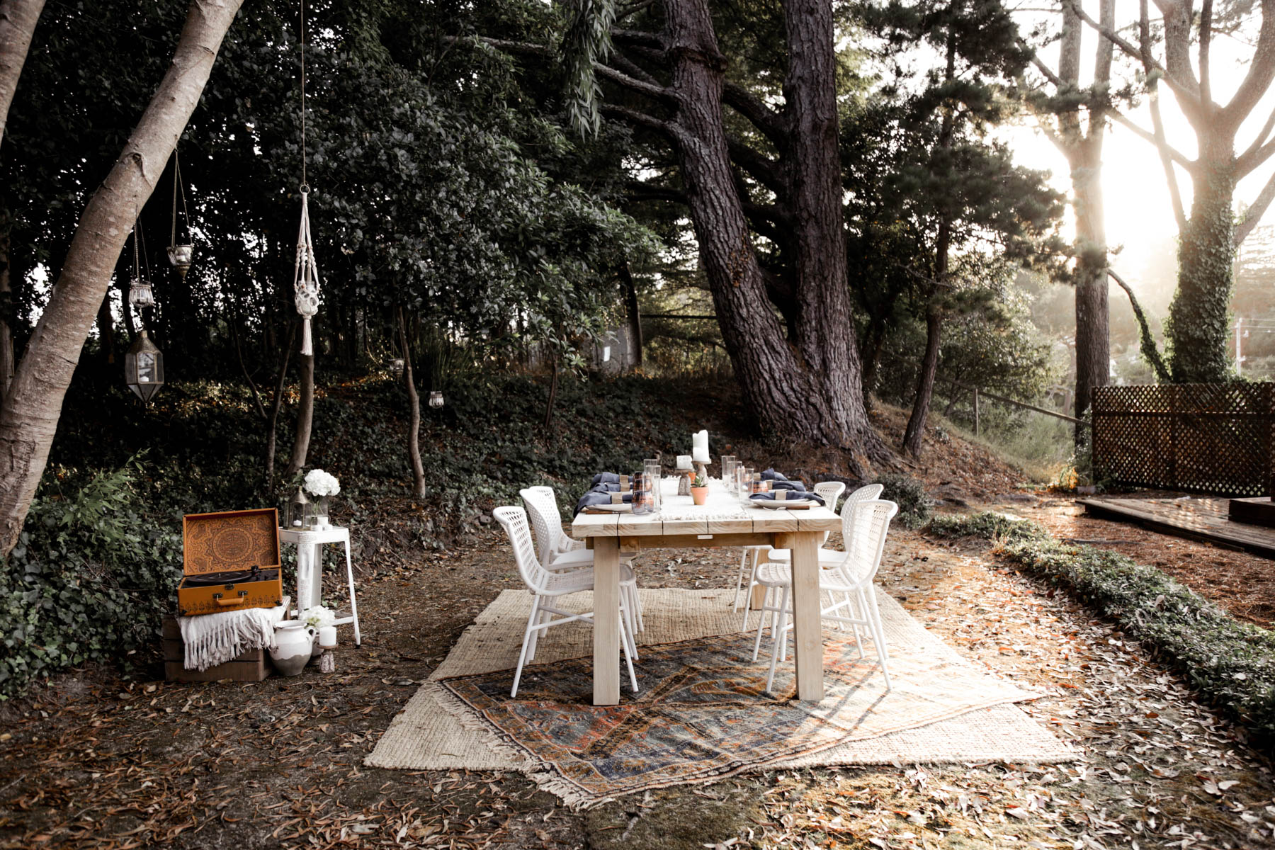 bohemian outdoor dining area with Article table and Urban Outfitters rug