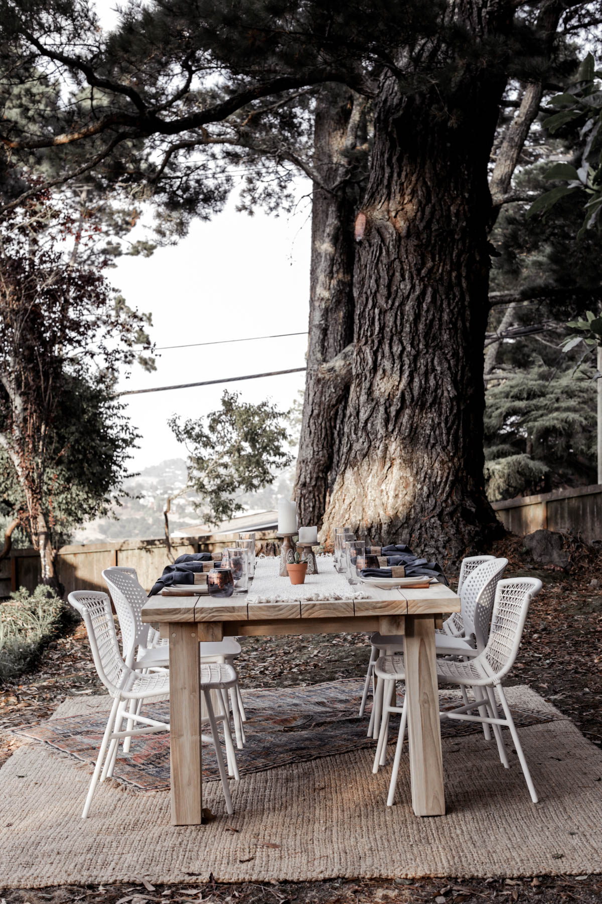 bohemian outdoor dining area with Article table and chairs