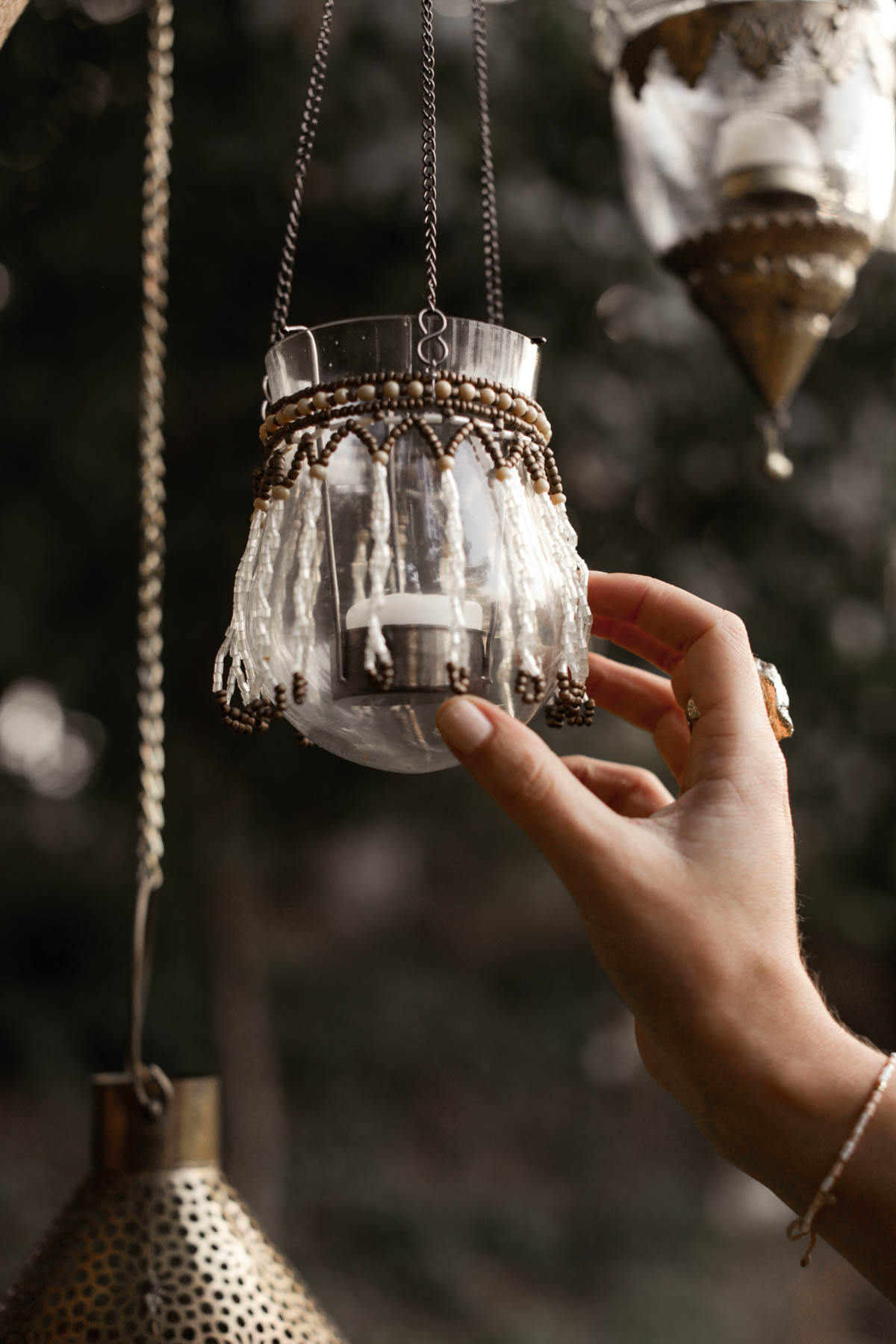 bohemian hanging lantern decor for outdoor dining area