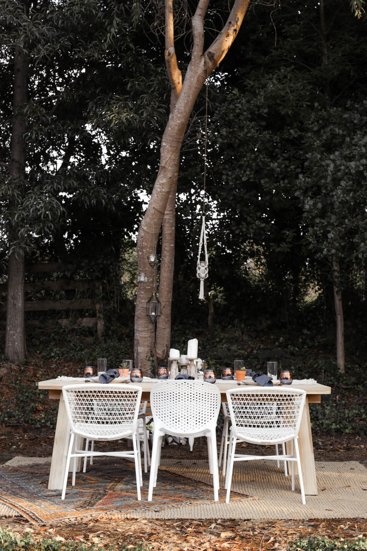bohemian outdoor dining area with Article chairs