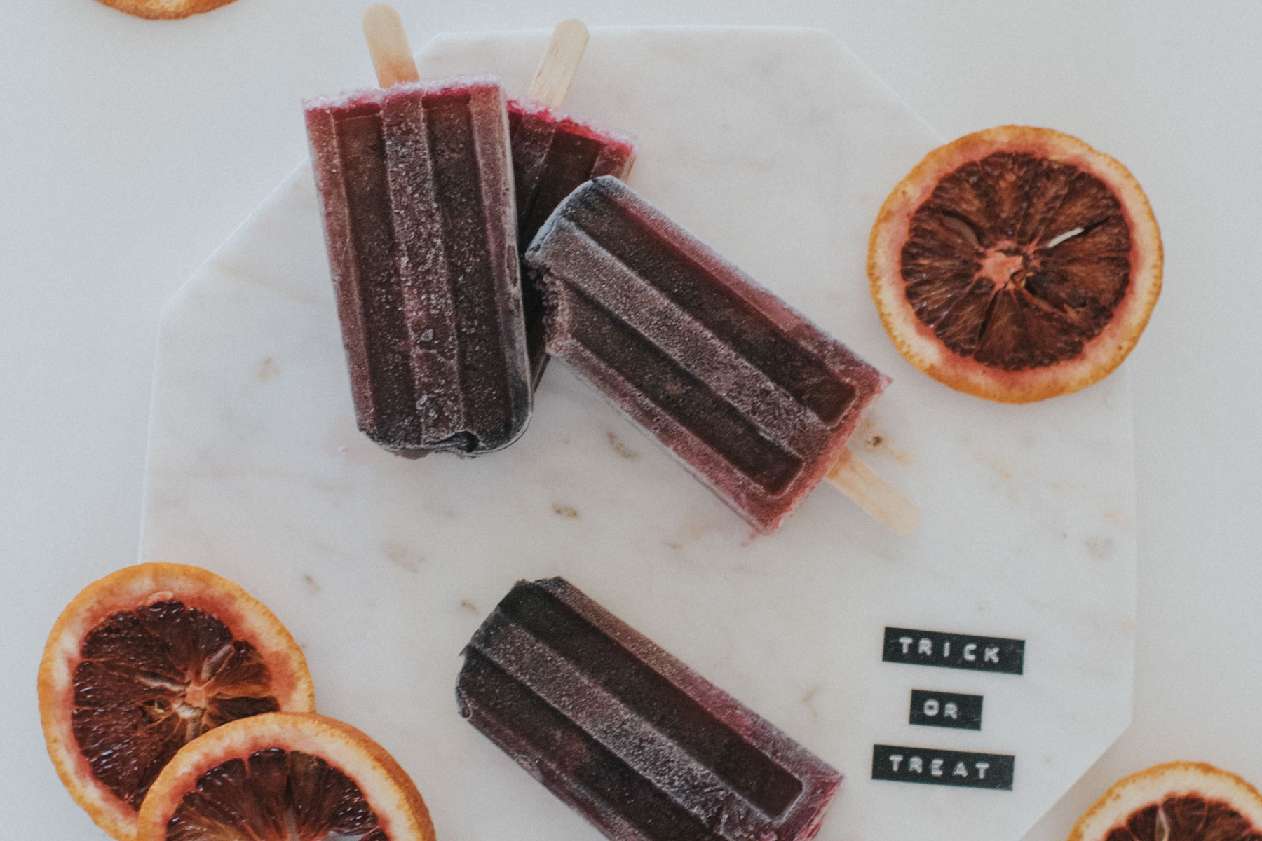 How to Make Boozy Black Popsicles for Halloween