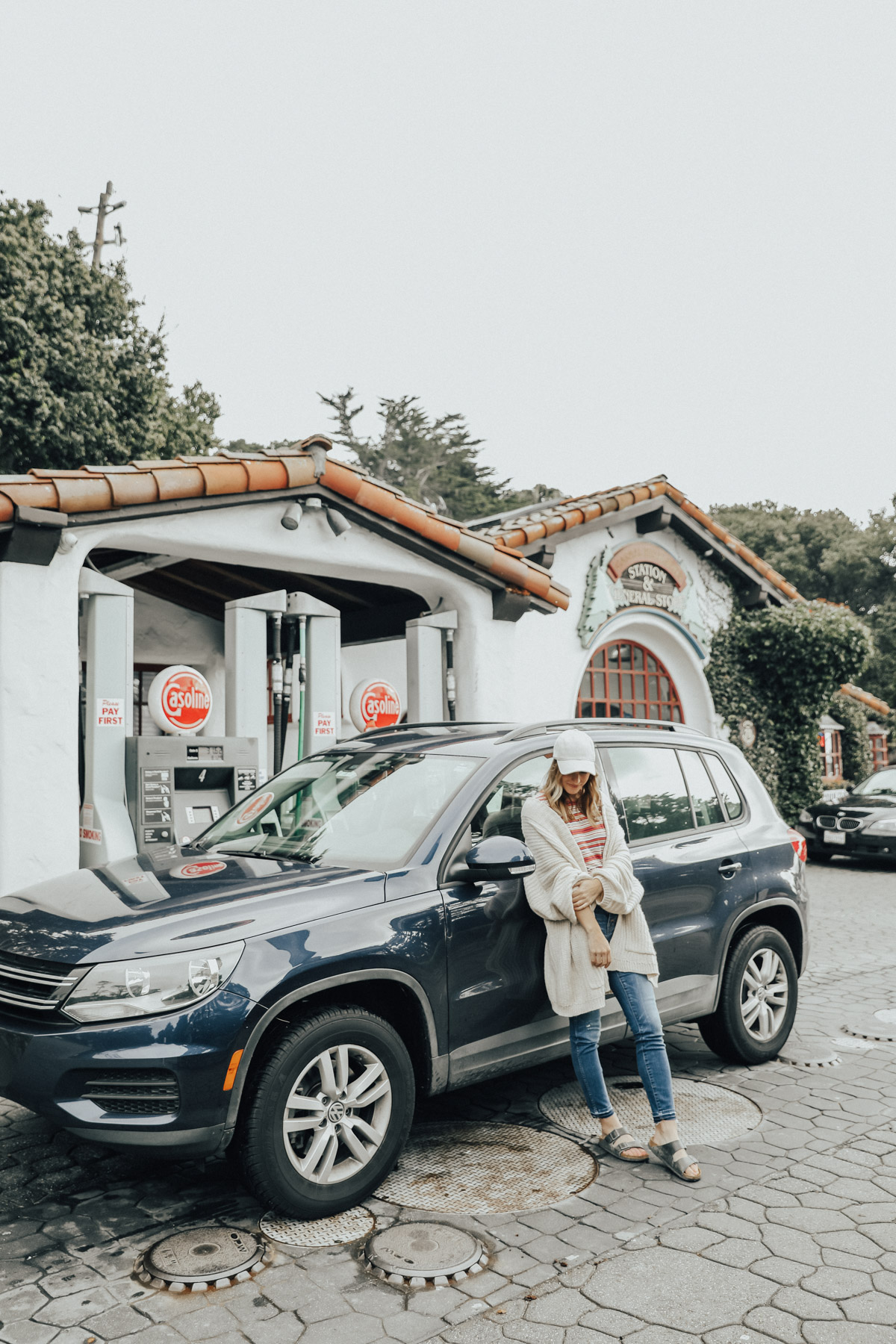 road trip tips and outfit at cute gas station in carmel